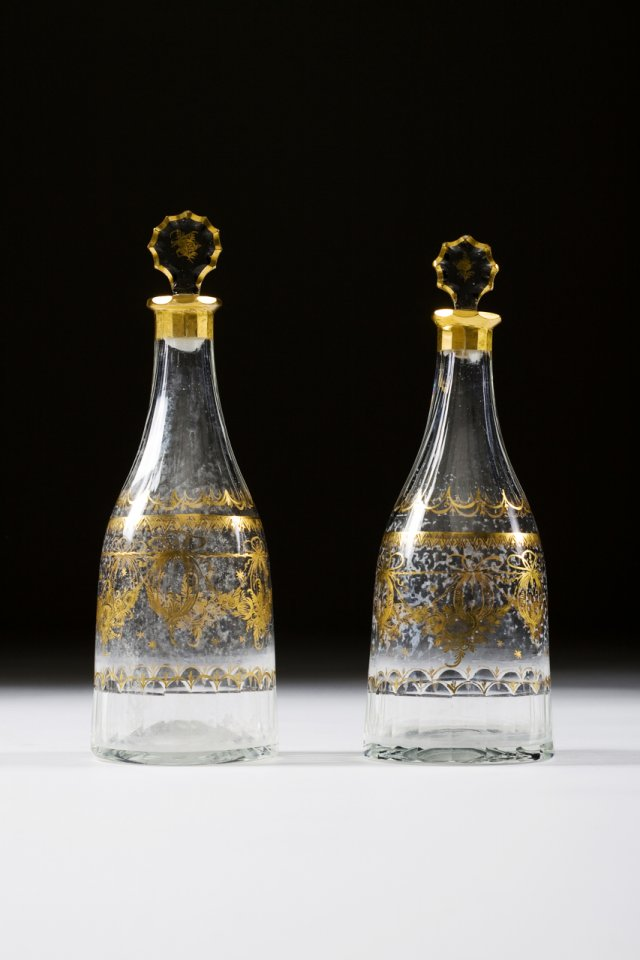 A late 18th century pair of glass bottles