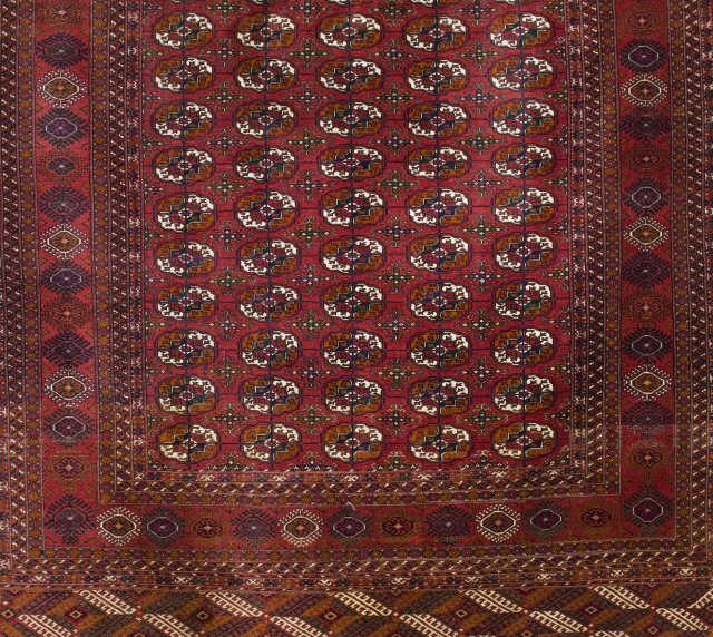 A cotton and wool oriental carpet in the Bokhara manner