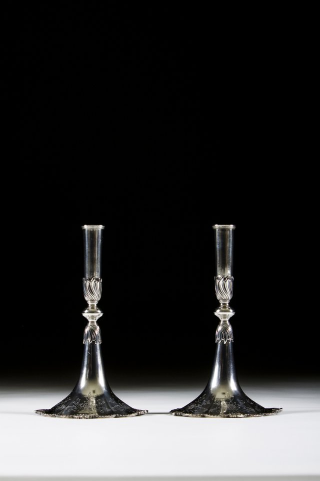 A pair of portuguese silver trumpet-shaped candlesticks