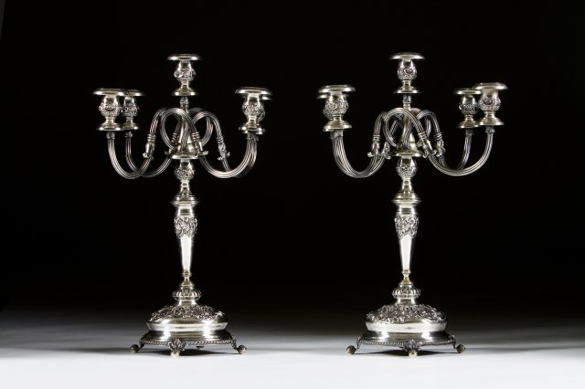 A portuguese silver pair of five light candelabra