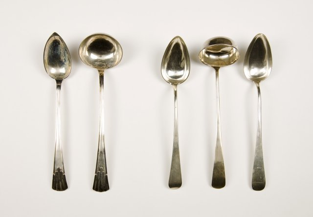 Two silver serving spoons