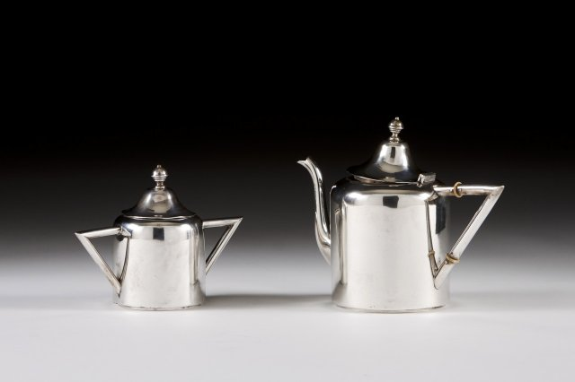 Silver tea-pot and sugar bowl