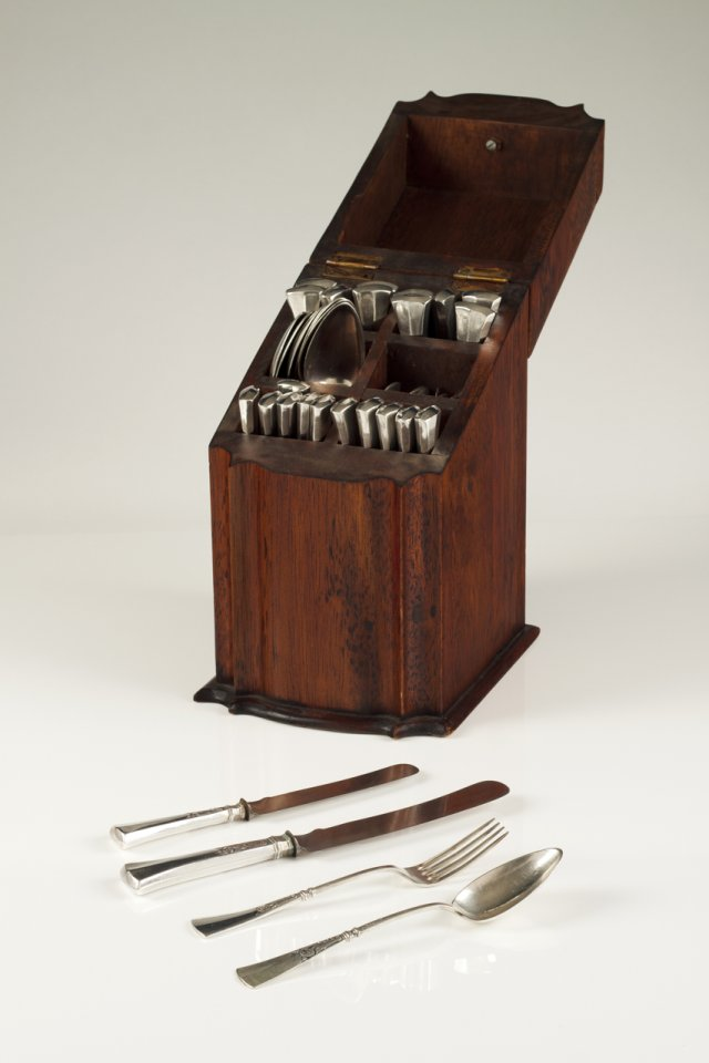 A carved wood flatware box