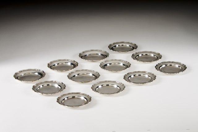 A set of 12 Portuguese silver bread plates