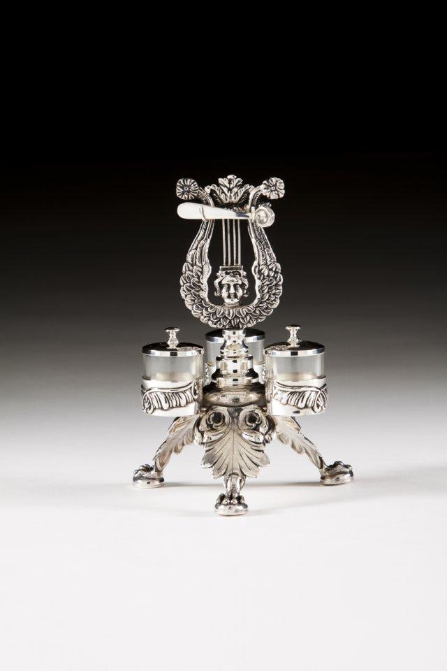 A silver three-piece condiment set