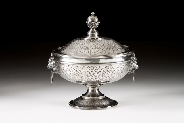 A Portuguese silver tureen on foot.