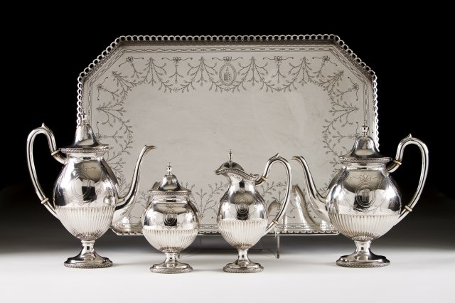 A Portuguese silver armorial coffee and tea set