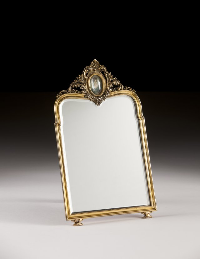 A portuguese silver gilt table mirror