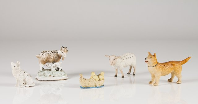 Five biscuit and glazed porcelain toothpick holders