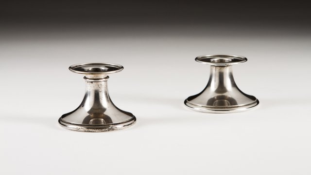 A pair of portuguese silver piano candlesticks