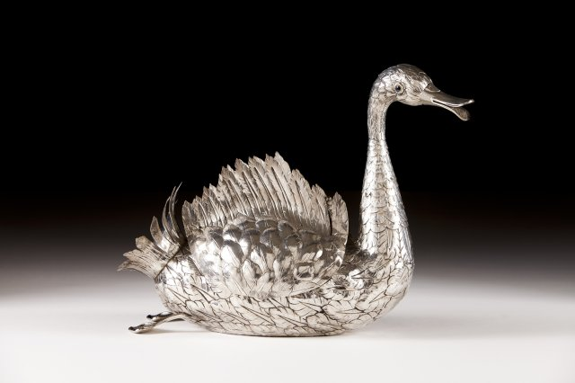 A portuguese silver flower vase in the form of a swan