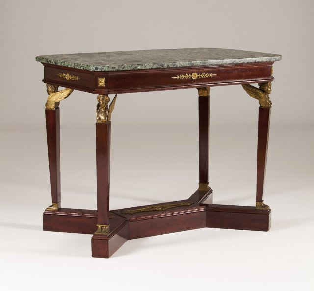 A bronze-mounted mahogany center table in the Empire manner