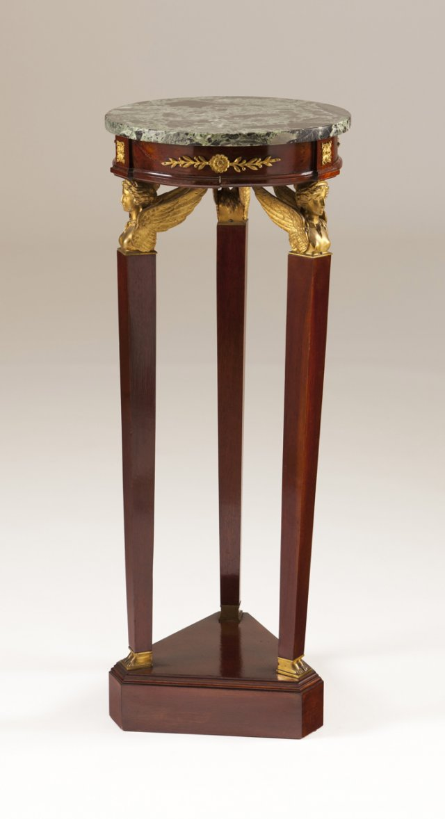 A bronze-mounted mahogany column/vase stand in the Empire manner