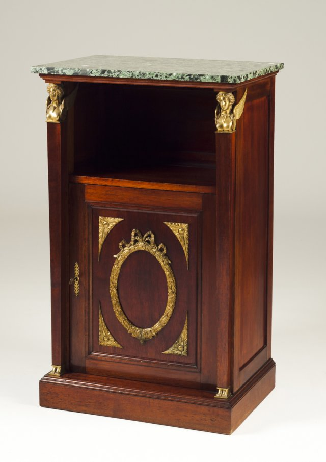 A bronze-mounted mahogany cabinet in the Empire manner