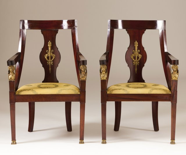 A pair of bronze-mounted mahogany fauteils in the Empire manner