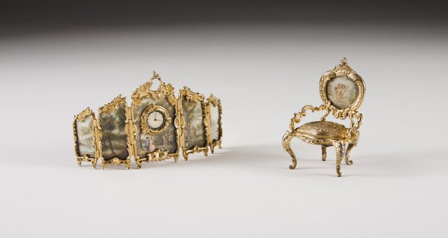 A miniature portuguese silver gilt screen with clock