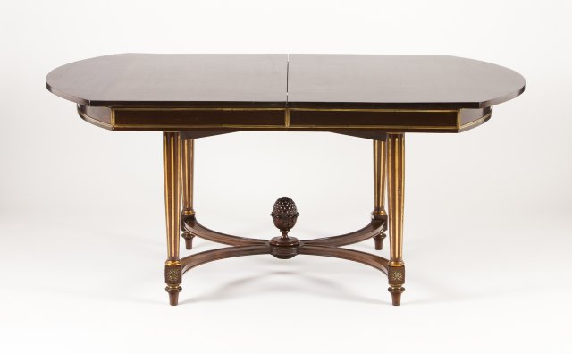 A Louis XVI style gil-bronze-mounted dinning table