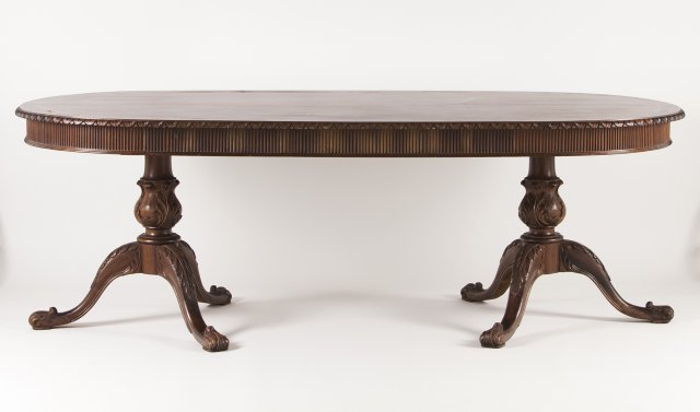 A carved wood romantic dinning table