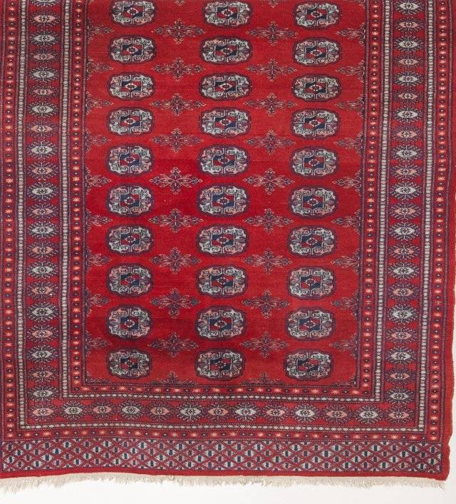 A Bokara oriental wool and cotton carpet