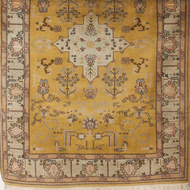 An oriental wool and cotton carpet