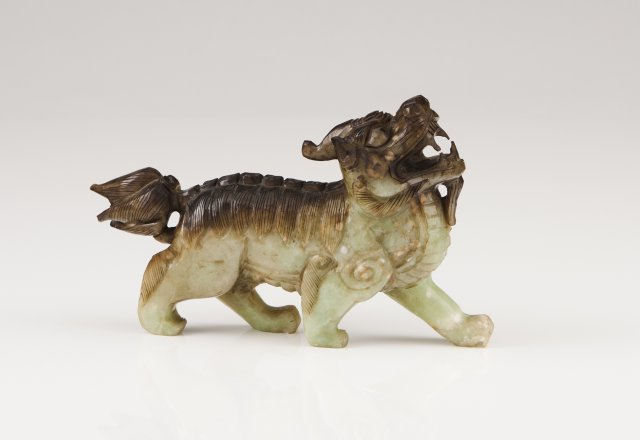 A carved green jade Qilin