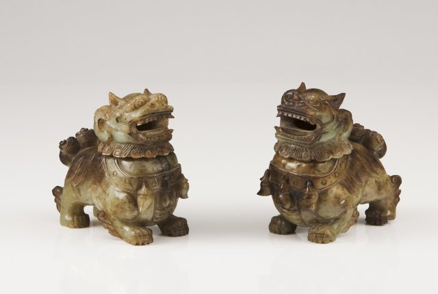 A pair of carved green jade censers
