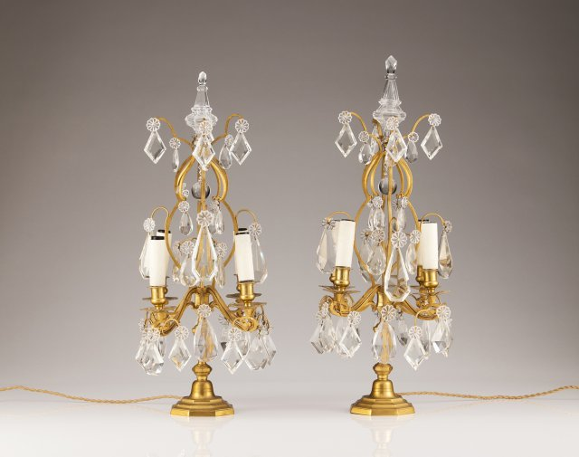 A pair of 19th century French cut glass and bronze girandoles