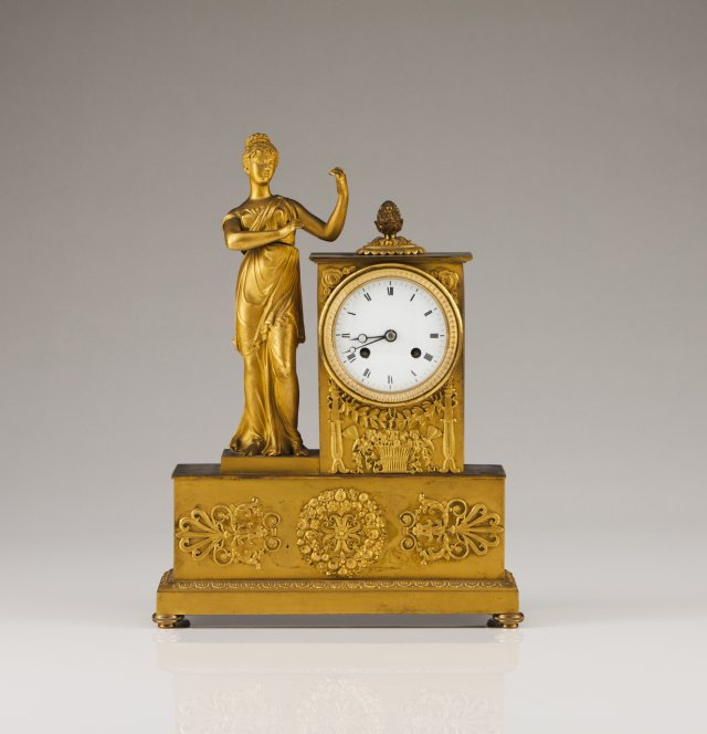 A 19th century French bronze table clock