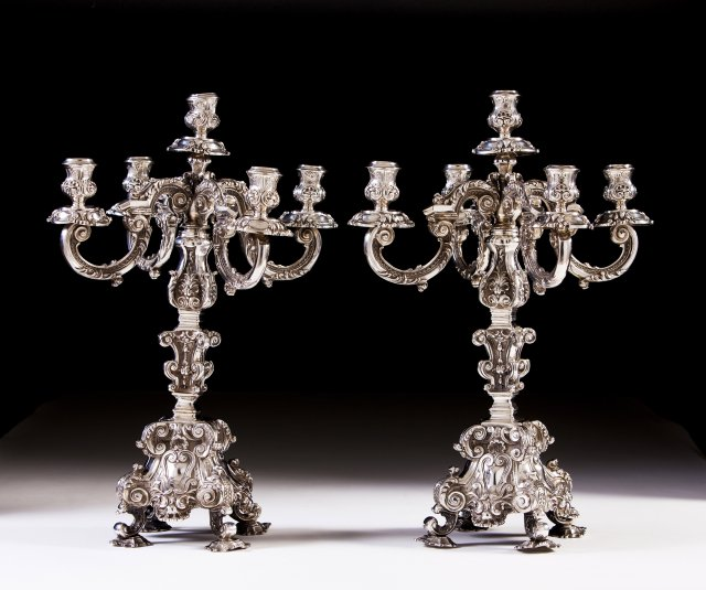 A Portuguese silver par of five-light candelabra