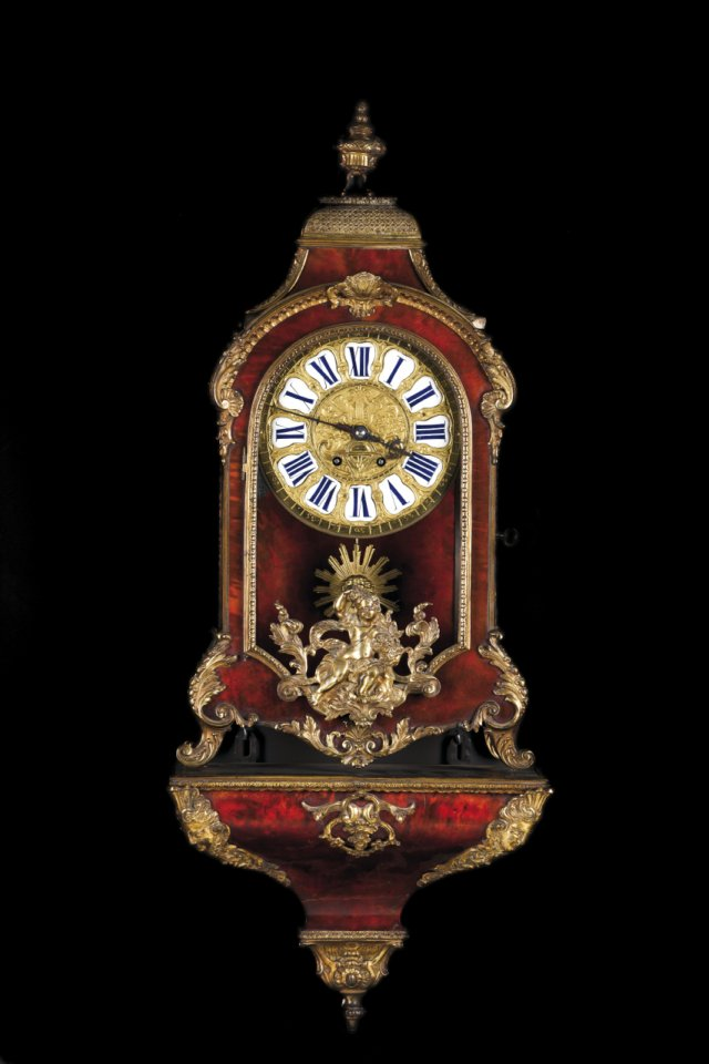 A Boulle style cartel clock