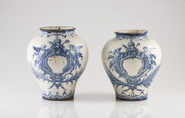 A pair of 18th century Rato faience Armorial baluster vases