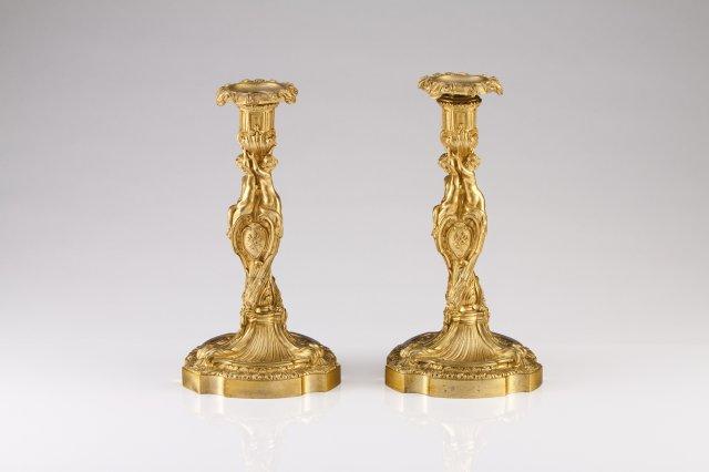 A pair o Louis XV ormolu candlesticks