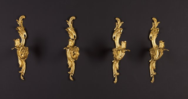 A pair of Louis XV style ormolu wall light