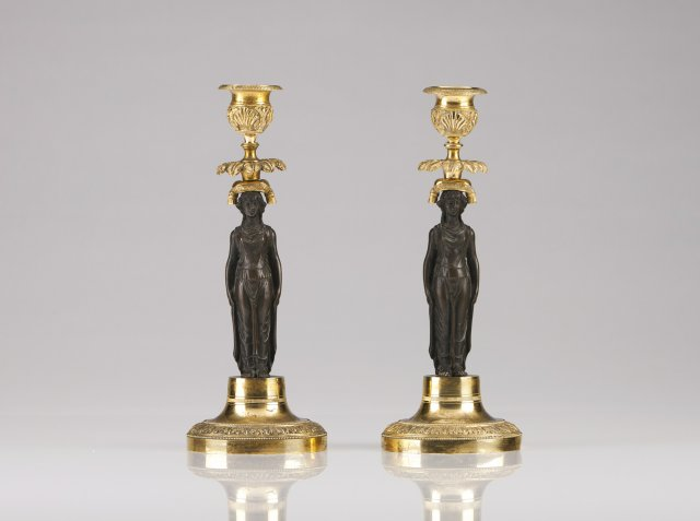 A pair of 19th century French gilt metal and patinated bronze candlesticks