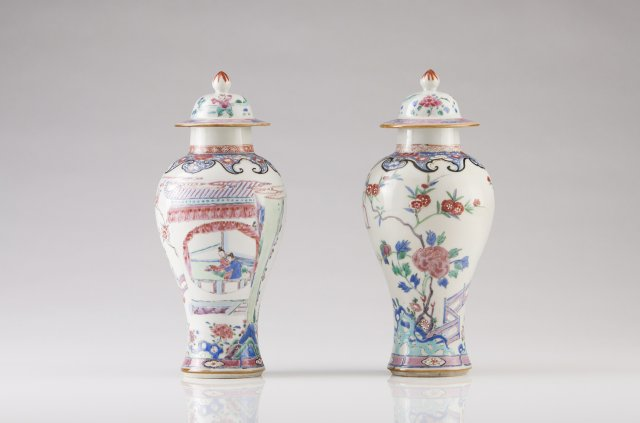 A pair of Qianlong baluster vases with covers