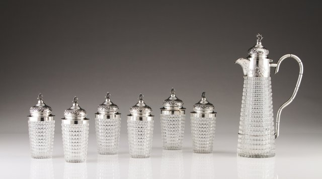 Six cut-glass cups and one decanter with Portuguese silver mounts, late 19th, early 20th century