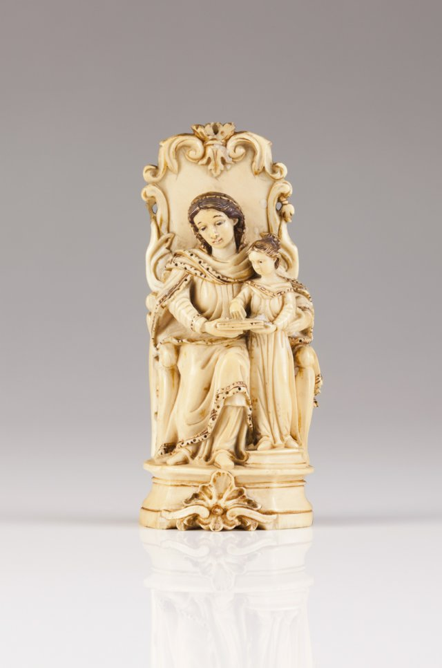 An 18th century Indo-Portuguese ivory sculpture of Saint Anne teaching Our Lady how to read