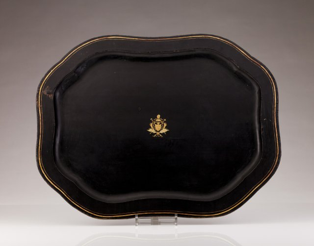 A black lacquered armorial tray