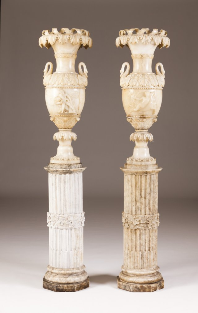 A pair of 19th century alabaster and plaster urns