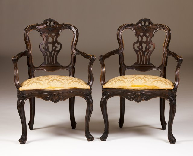 A pair of 19th century Portuguese walnut fauteils