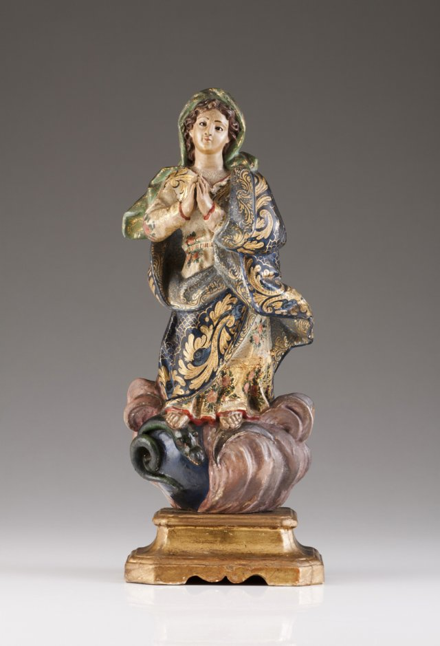 A wood sculpture of Our Lady of the Conception