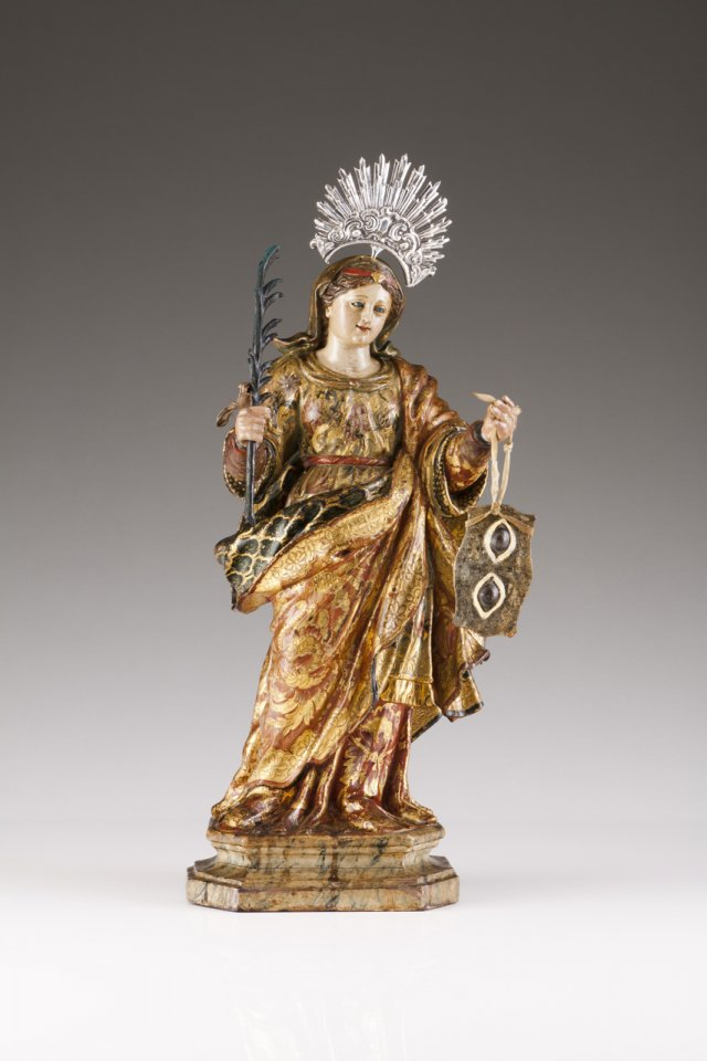 An 18th century wood sculpture of Saint Lucy