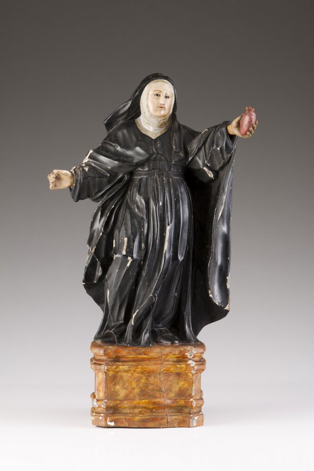 An 18th century Portuguese carved wood sculpture of Saint Margaret Mary Alacoque