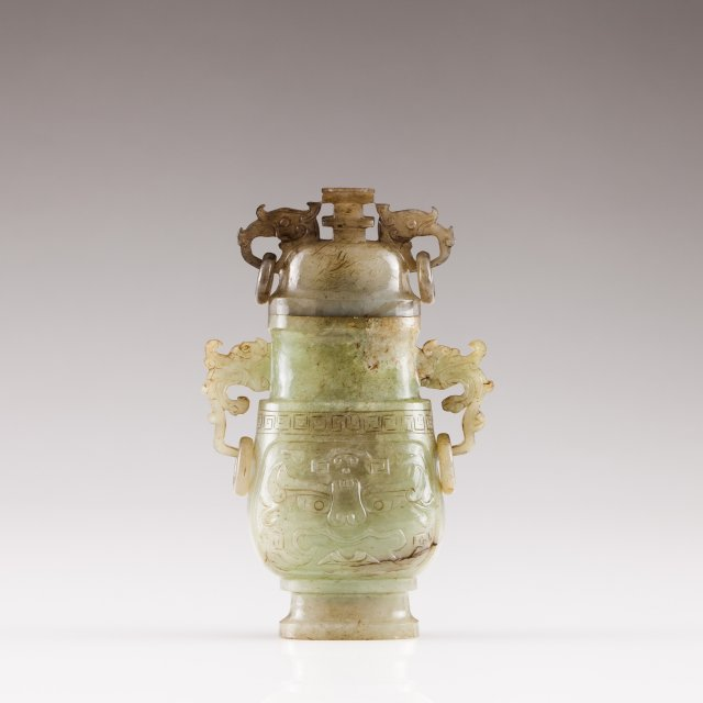 A green jade vase with cover