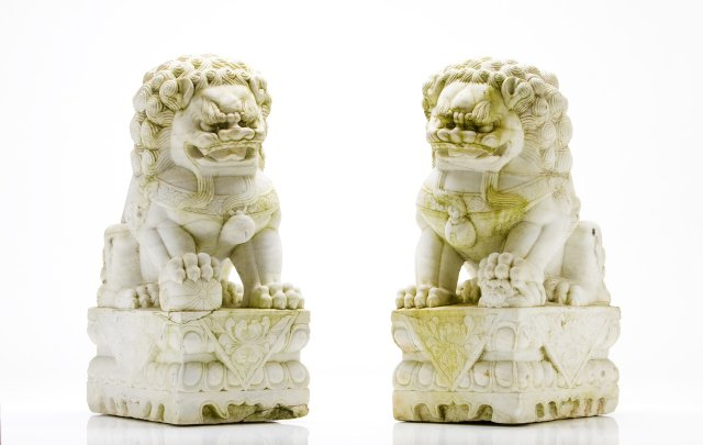 A pair of late 19th, early 20th century Oriental marble dragons