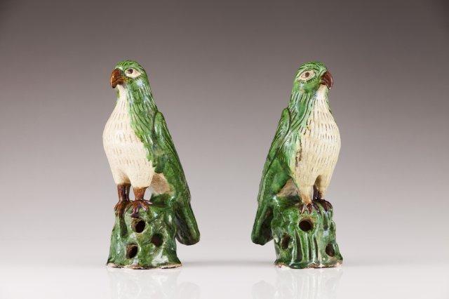 A pair of stoneware parrots