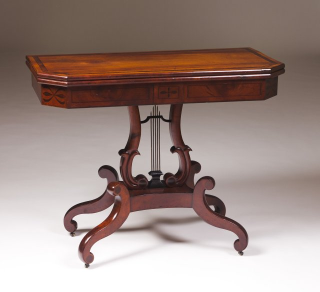 An Empire mahogany card table