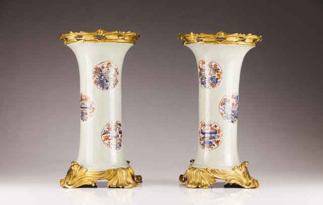 A pair of ormolu-mounted Kangxi beaker vases