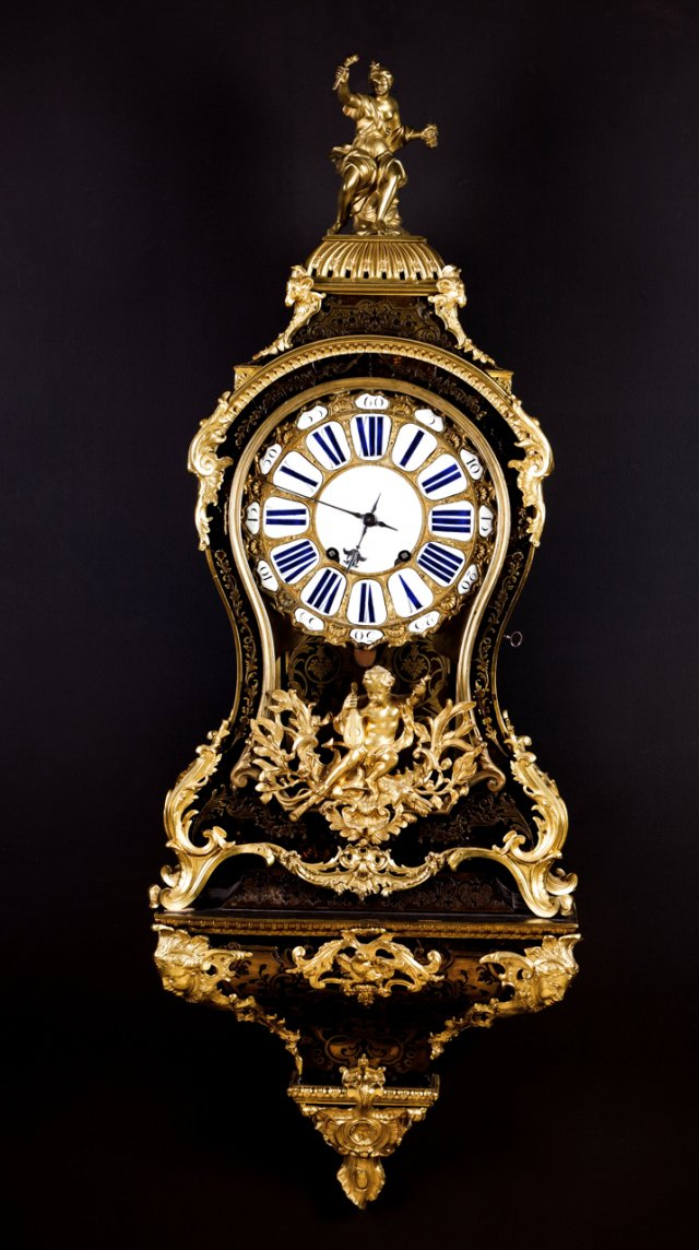 A large 18th century Louis XV cartel clock