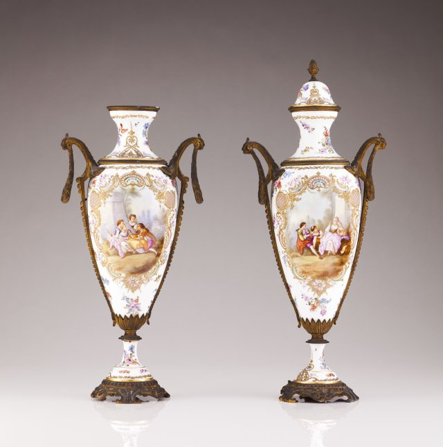 A pair of 19th century French porcelain urns